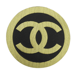 Black on bright gold paper circle Chanel foil label