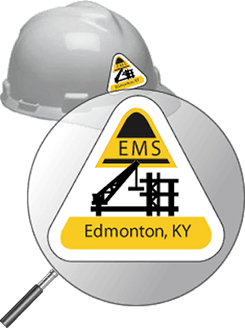 Example of closeup image of a triangular shaped hard hat label and a construction helmet with the triangular label applied