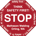 Red on white vinyl stop sign Matheson Welding hard hat decal
