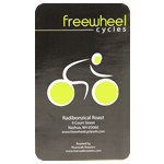 Black and yellow cyclist logo and address on white gloss rectangle Freewheel Cycles custom roll label