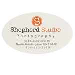 Orange and black logo and address on white oval Shepard Studio Photography custom roll label sample