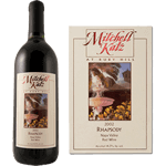 Outdoor fountain scene with red foil Mitchell Katz custom wine label on wine bottle