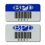 Two asset tags with human readable code 39 barcode with different header styles