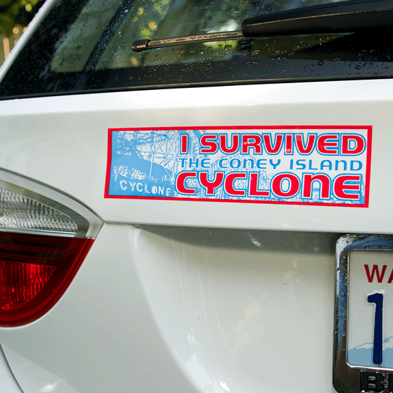 Red and blue on white vinyl i survived cyclone bumper sticker on car