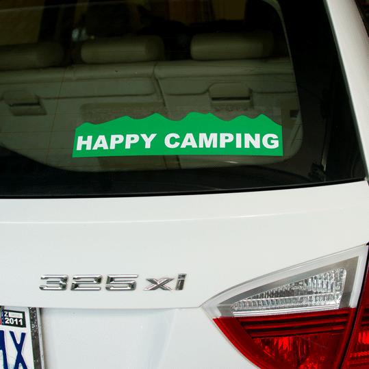 Green on white vinyl custom shape happy camping bumper sticker on car