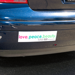 Pink and green on white vinyl Love Peace Beauty bumper sticker on car
