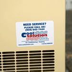 Blue and red on white vinyl rectangle Cool Solution Inc. Need Service weatherproof label on outdoor air conditioner