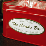 Red tin candy box with white and gold foil product label