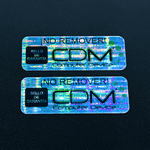 "Rectangle label with CDM logo printed on ""Secured - Void If Removed"" material with Black ink."
