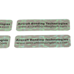 Black ink on holographic void material rectangle Aircraft Bonding Technologies tamperproof security label sample