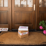 Two boxes with packaging tape at door step