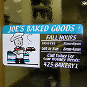 Multi spot color bakerman with goodies graphic on clear rectangle Joe's Baked Goods custom window decal on window